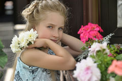 Sad girl with a wreath of flowers Royalty Free Stock Image