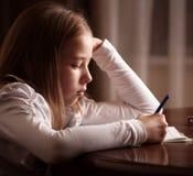 Sad girl writing Stock Photos