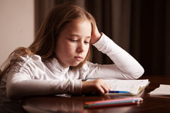 Sad girl writing stock images