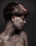 Sad girl with writing and erased text on her body. Lonekiness and depression royalty free stock image