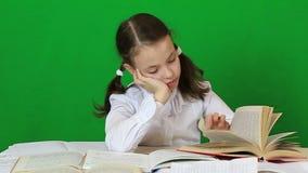 Sad girl writing, reeding. Child doing homework stock video
