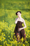 Sad girl in yellow field Royalty Free Stock Photos