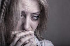 Sad girl. Young sad girl crying on a dark background Royalty Free Stock Photography