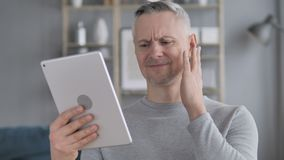 Sad Gray Hair Man in Awe for Losing Online on Tablet. 4k high quality, 4k high quality stock footage