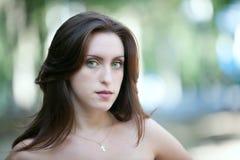 Sad green-eyed girl Stock Photos