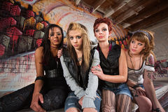 Sad Group of Girls. Sad group of young women sitting together in garage Royalty Free Stock Image