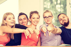 Sad group of students giving thumbs down Stock Images