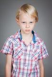 Sad grumpy young boy Stock Photos