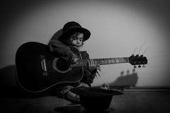 Sad guitar player Stock Photos