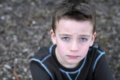 SAD gullig framsida för pojke Royaltyfri Bild