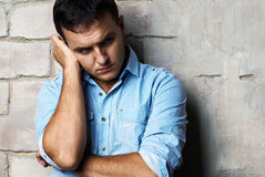 Sad guy against wall Royalty Free Stock Image