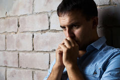 Sad guy against wall Stock Photos