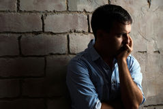 Sad guy against wall Royalty Free Stock Images