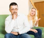 Sad guy and angry woman during quarrel Stock Image