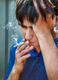 Sad Guy with Cigarette Royalty Free Stock Photo