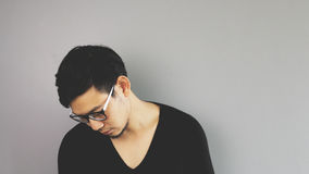 Sad guy face down. An asian man with black t-shirt royalty free stock images