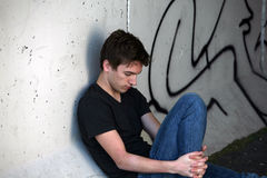 Sad guy and graffitti Royalty Free Stock Image