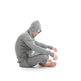 Sad guy sitting and looking down Royalty Free Stock Photography