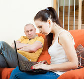 Sad guy and woman with laptop during conflict Stock Photo