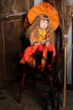 sad halloween witch girl in costume with broom Stock Photo