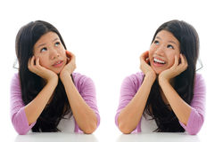 Sad and happy face expression. Of Asian woman, hands holding face sitting isolated over white background Royalty Free Stock Photography