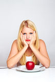 Sad healthy woman with apple Stock Images