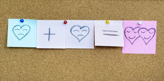 Sad heart plus sad heart equals two smiling hearts.Drawn hearts Royalty Free Stock Photography