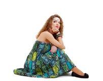 Sad hippie girl sitting on the ground Stock Photos