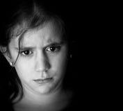 Sad hispanic girl on a black background Royalty Free Stock Images