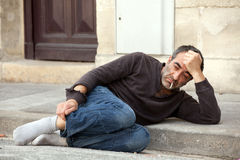 Sad homeless man Stock Photos