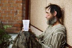 Sad homeless man. Homeless poor alcoholic in depression stock photos