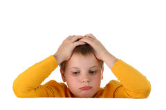 Sad hopeless boy holding head with hands on white. Portrait of a preteen boy wearing yellow top, partly hidden behind a horizontal invisible empty banner Stock Photos