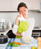 Sad housewife cooking dinner Stock Images