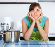 Sad housewife cooking dinner Royalty Free Stock Images