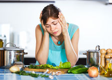 Sad housewife cooking dinner Royalty Free Stock Image