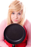 Sad housewife with pan Stock Photo