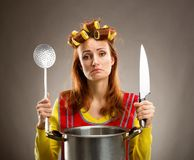 Sad housewife with sause pan Royalty Free Stock Photo