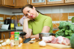 Sad housewife tired to cook Royalty Free Stock Image