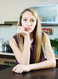 Sad   houswife sitting  at  kitchen. Lonely sad   houswife sitting  at  kitchen Royalty Free Stock Images