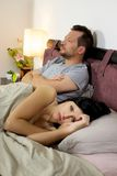 Sad husband and wife after fighting at home in bed Royalty Free Stock Photo