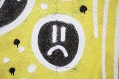 Sad icon. Drawn on urban wall decoration Royalty Free Stock Image
