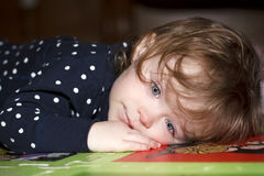 Sad and ill little girl Stock Images
