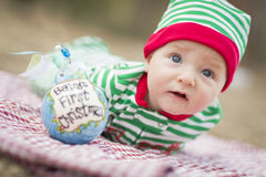 Sad Infant Baby On Blanket With Babys First Christmas Ornament Stock Photography