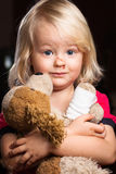 Sad injured little boy holding stuffed toy Royalty Free Stock Image