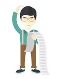 Sad japanese employee holding a list of payables Royalty Free Stock Photos