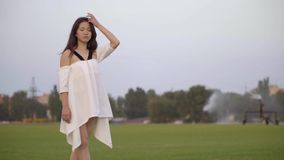 Sad Japanese girl standing on the lawn stock footage