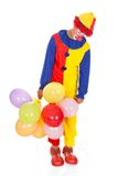 Sad Joker With Balloons. Portrait Of A Sad Clown With Multi Colored Balloons On White Background Royalty Free Stock Photos
