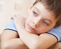 Sad kid Stock Images