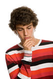 Sad kid. Young sad teenager man isolated on white Royalty Free Stock Photos