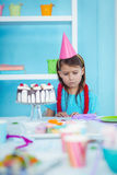 Sad kid alone at her birthday. Party Stock Photography